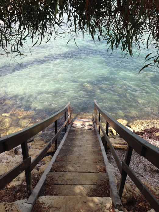 Wooden steps into the sea