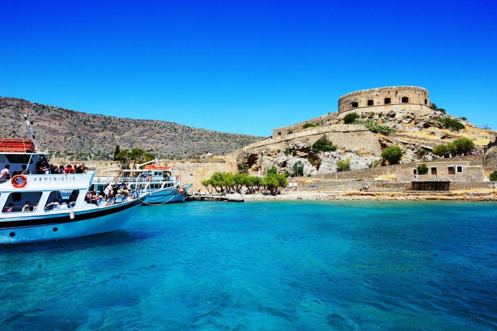 Day trips to Spinalonga begin with a gentle boat ride to the island