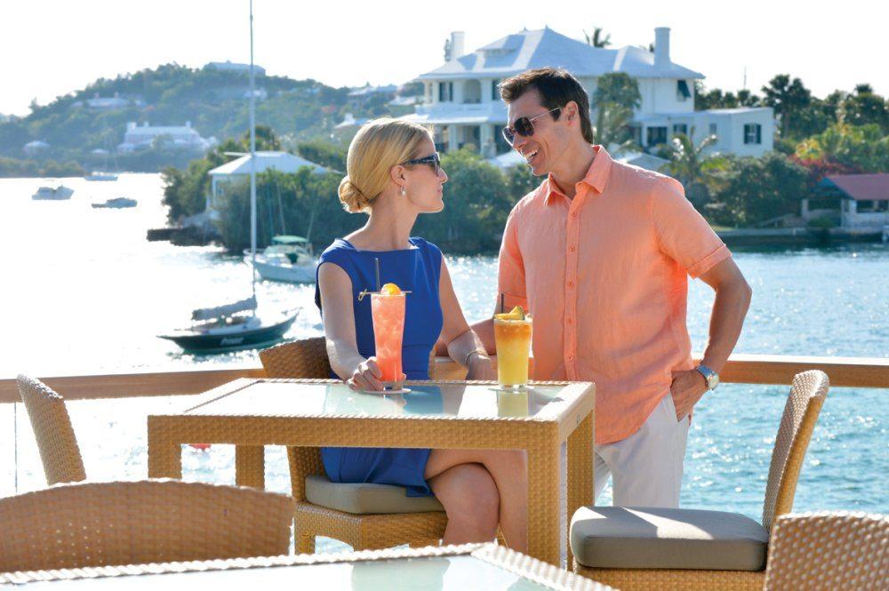 Couple drinking rum in bermuda