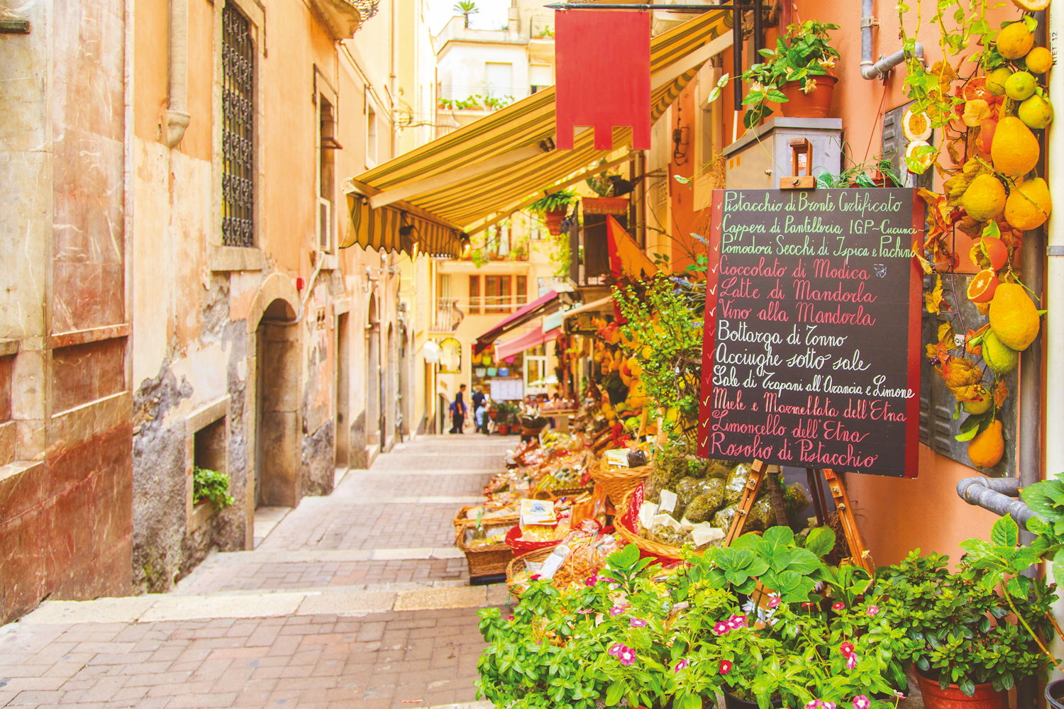 Taormina street with local market shops