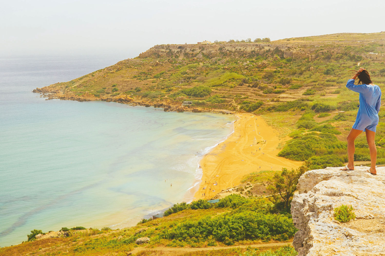 woman overlooking ramla bay, gozo