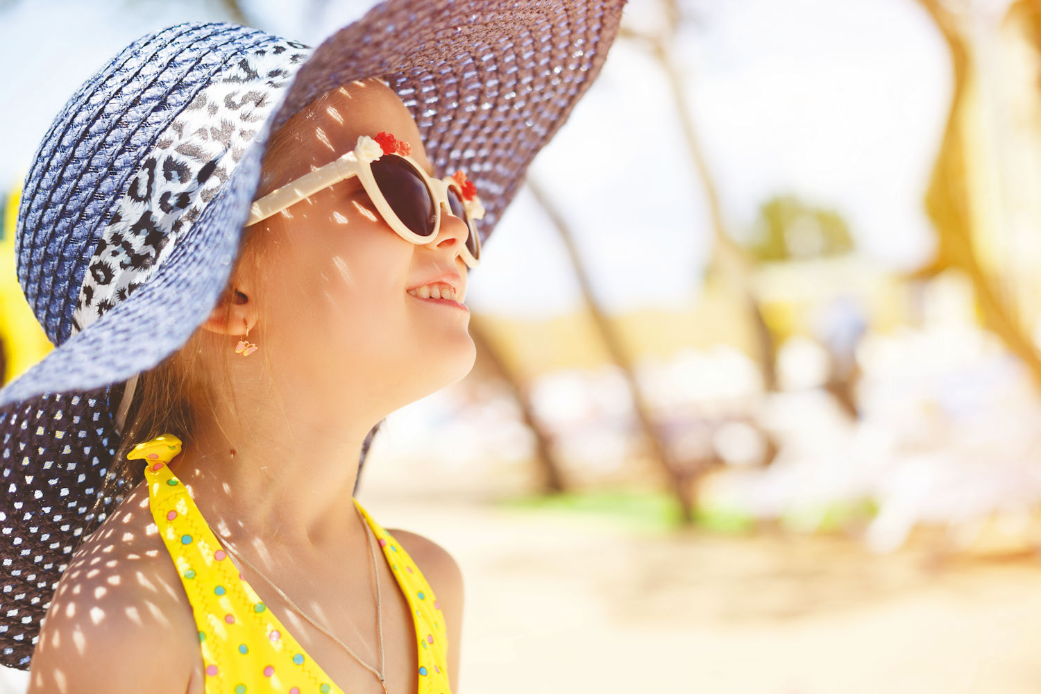 girl in sunhat on holiday