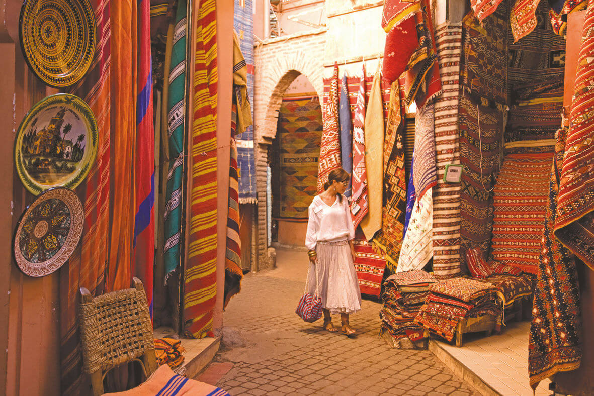 Woman shopping in souks of Marrakech
