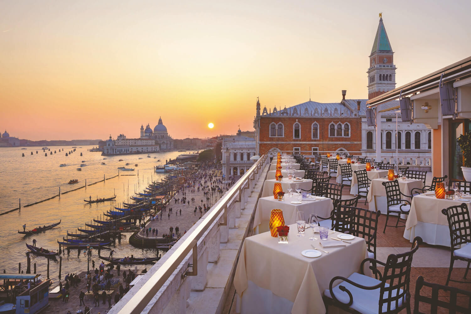 evening dining in venice overlooking lagoon and sunset