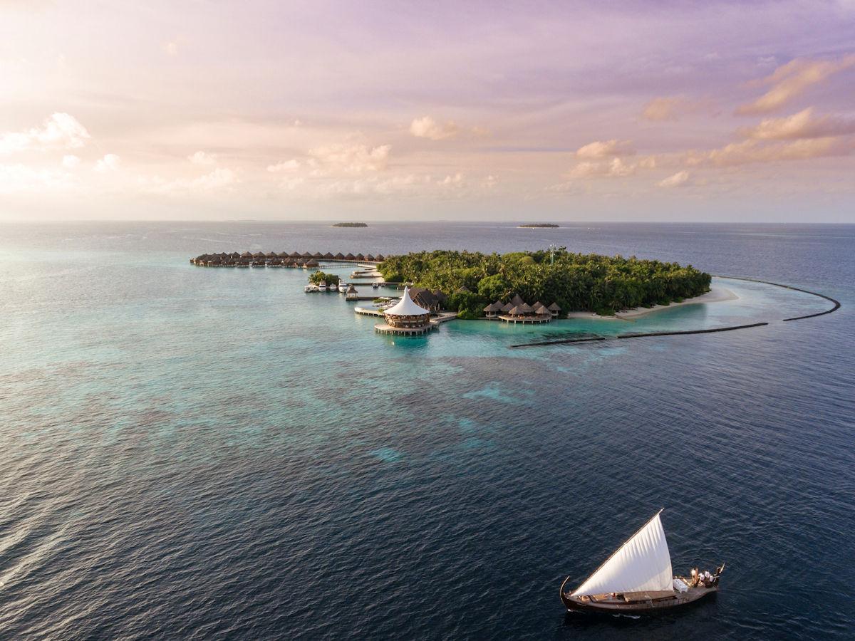 Aerial View of the Baros Maldives at sunset