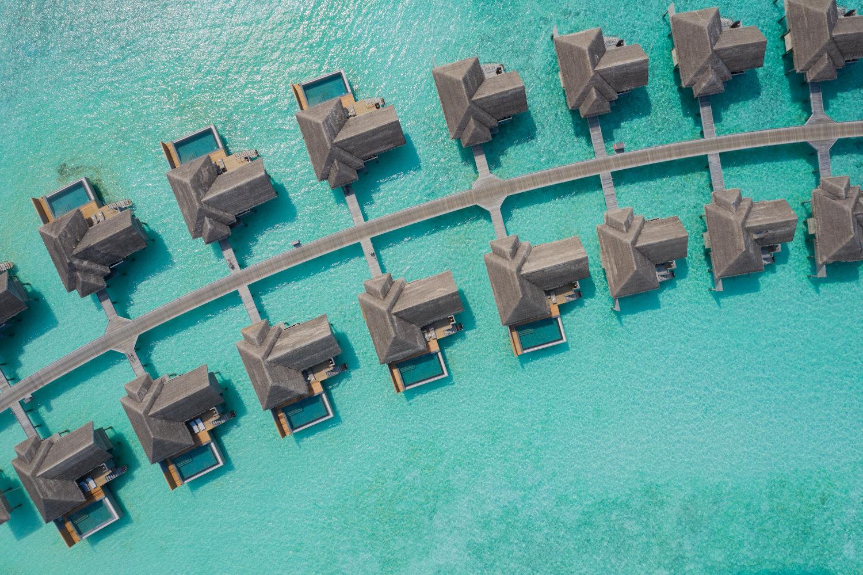 Aerial view of overwater family pool villas at Vakkaru Maldives