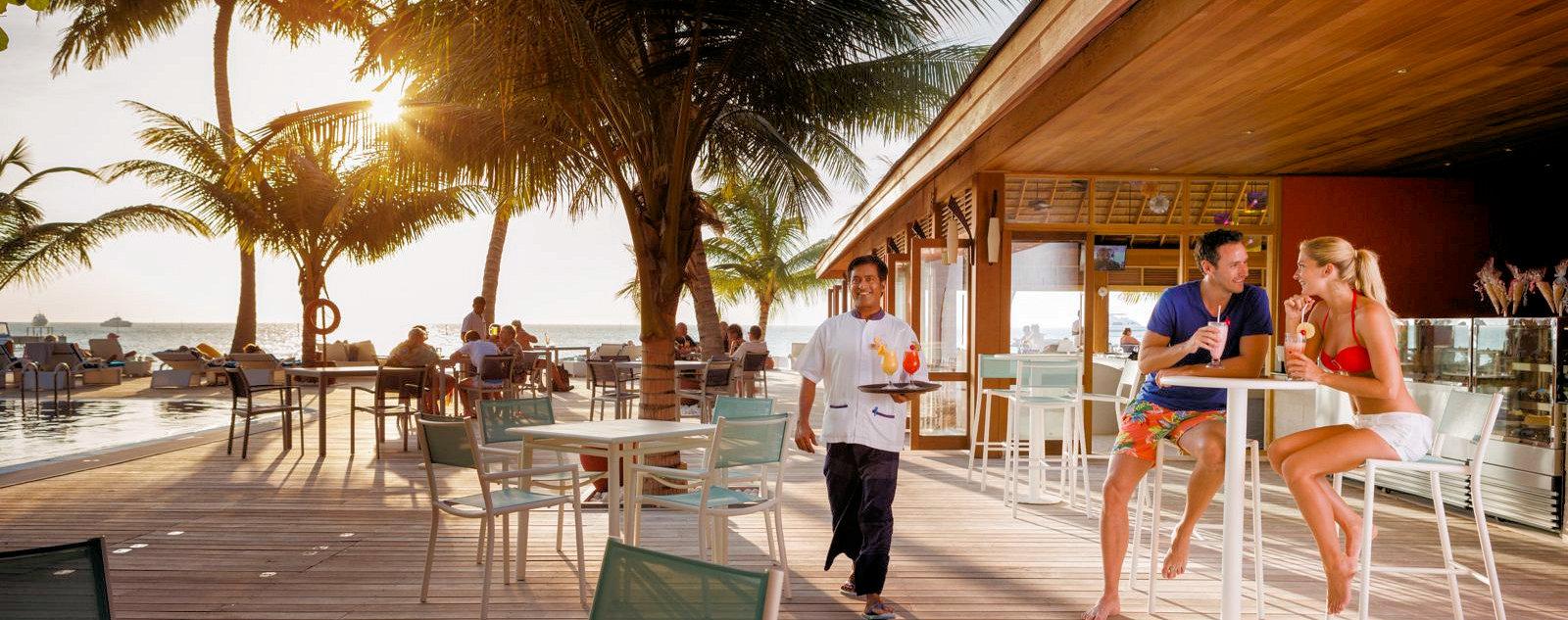 Staff and guests at Meeru Cafe, Meeru Island Resort & Spa